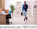 Young male employee in oversleeping concept 76071919