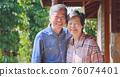 asian retired couple enjoy travel 76074401