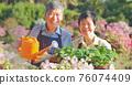 senior couple watering the garden 76074409