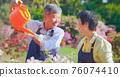 senior man watering the garden 76074410