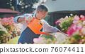 senior man watering the garden 76074411