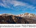Snow Capped Mountain Range of the Paganella in Winter - Alps Trentino Italy 76079649