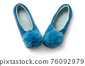Felt slippers on white background in closeup 76092979