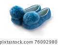 Felt slippers on white background in closeup 76092980