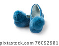Felt slippers on white background in closeup 76092981