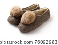 Felt slippers on white background in closeup 76092983