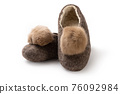Felt slippers on white background in closeup 76092984