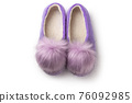 Felt slippers on white background in closeup 76092985