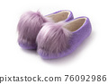 Felt slippers on white background in closeup 76092986