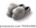 Felt slippers on white background in closeup 76092989