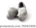 Felt slippers on white background in closeup 76092990