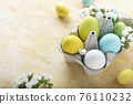 Easter eggs and flower 76110232