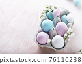 Easter eggs and flower 76110238