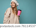 Photo shot of attractive smiling amazing young blonde woman wearing winter warm stylish clothes and 76114537