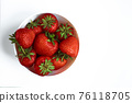 Strawberries on white background. Berries in a plate 76118705