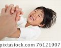 A boy with a good laugh 76121907