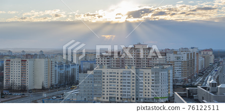 Minsk roofs of houses at sunset 76122511
