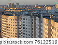 Minsk roofs of houses at sunset 76122519