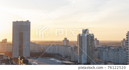 Minsk roofs of houses at sunset 76122520