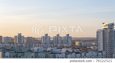 Minsk roofs of houses at sunset 76122521