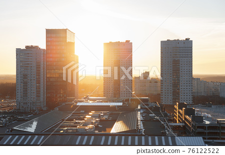 Minsk roofs of houses at sunset 76122522