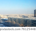 Architecture of modern city, skyline and blue sky in frosty weather in winter 76125448