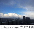 Architecture of modern city, skyline and blue sky with snowfall 76125450