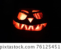 Halloween pumpkin in the dark with scary smile 76125451