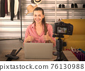 female blogger recording review video at home. 76130988