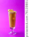 Orange and coffee cocktail topping sliced orange on a purple background. 76139801