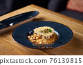 Italian cuisine, risotto from rice and mushrooms. 76139815