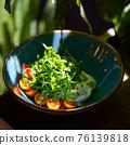 Italian fresh cheese Burrata with colorful cherry tomato salad, arugula and basil with pesto sauce 76139818
