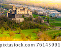 aerial view of the medieval fairy castle with a colorful river and yellow lights at the edges 76145991