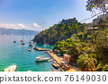 beautiful colorful view Gulf of Portofino Italy with castle Brown in background and boats anchored 76149030