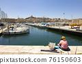 View of Marseille's Vieux Port and Notre Dame de la Garde church, France 76150603