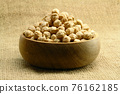 A cup of chickpea on sackcloth 76162185