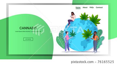 mix race women putting cannabis leaves on world map global marijuana legalization drugs consumption concept horizontal copy space 76165525