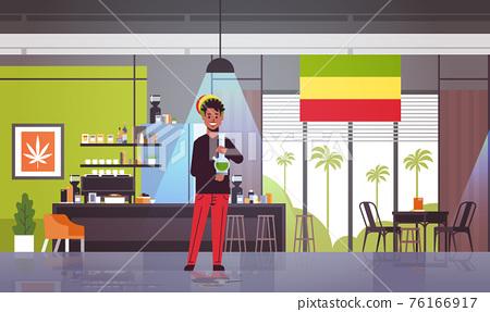 african american guy smoking marijuana with bong rastaman relaxing cannabis smoking hookah system coffeeshop interior full length horizontal 76166917