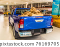 Blue pickup truck loaded with luggage 76169705
