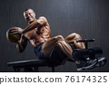 fit man training abs muscles at gym 76174325