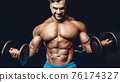 fit man training arm muscles at gym 76174327