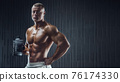 Fit man at workout in gym with shaker 76174330
