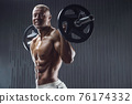 fit man training muscles at gym 76174332