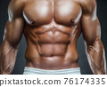 fit man training abs muscles at gym 76174335