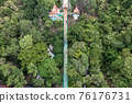 Top view of Tourists walking on long stair up to the temple in tropical forest 76176731