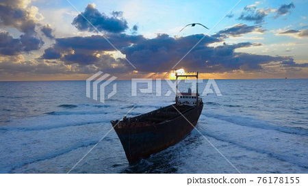 Aerial view of the sea and ship aground 76178155