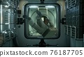 astronaut inside the orbital space station 76187705