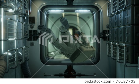 astronaut inside the orbital space station 76187705