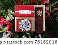 Set of red gift boxes and flowers 76189016