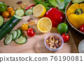 Healthy food clean eating selection: fruit, vegetable, seeds, superfood, leaf vegetable and 76190081